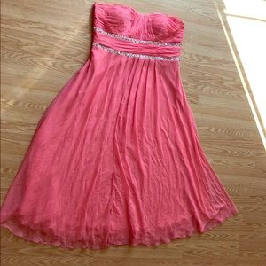 A beautiful salmon strapless event dress